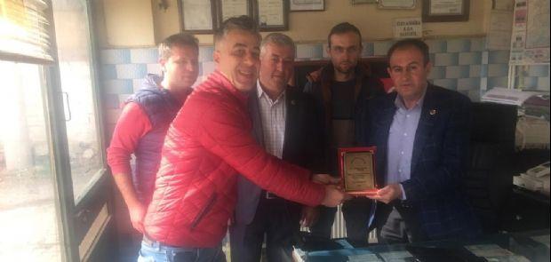 HAYIRSEVER İŞ ADAMI AHMET TEZCAN'A PLAKET